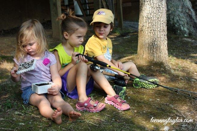 three kiddos on the bank